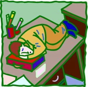 Child Sleeping on Desk